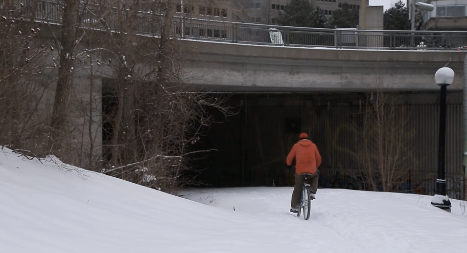 Shot in Canada's capital city, Snovlo integrates visual poetry and sound to trace a man's life journey over a ten minute bike ride towards an impending snowstorm.