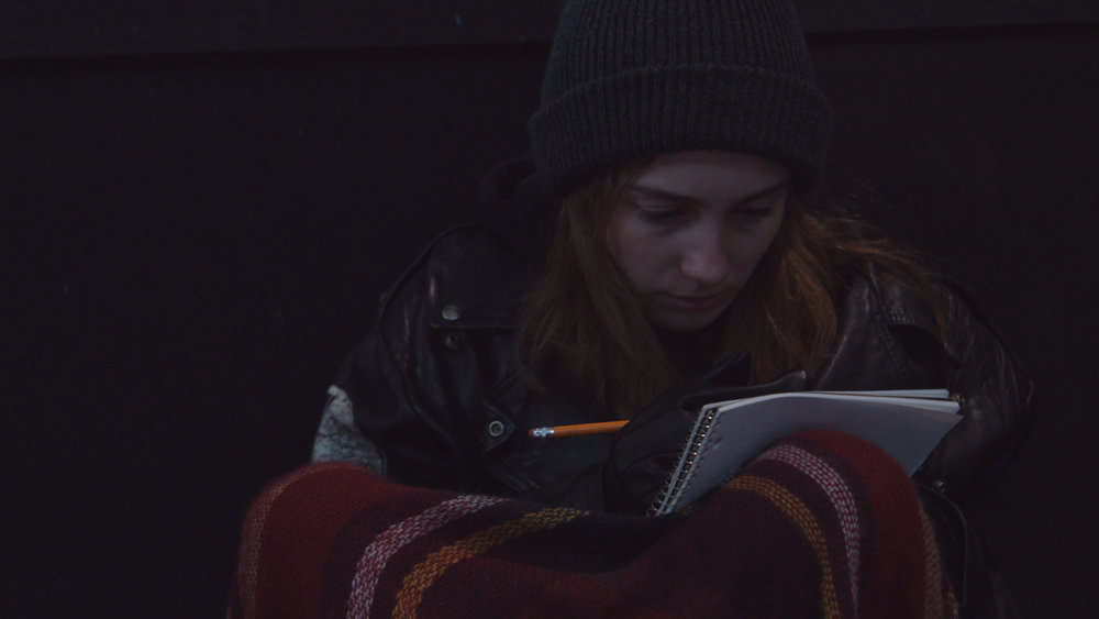 Checking for Change (6:07) Isabel Estabrook  A young banker ignores the protests of her friend when personal history compels her to help someone in need.