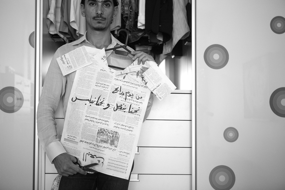 """from now on we wear what we sew"" it's a modification of a Syrian proverb that says ""you sew and we wear"" Rami Al Ali - fashion designer, Damascus 14/8/2011  30x45cm ed of 3+1AP Printed on Cotton Rag Fine Art Archival paper"