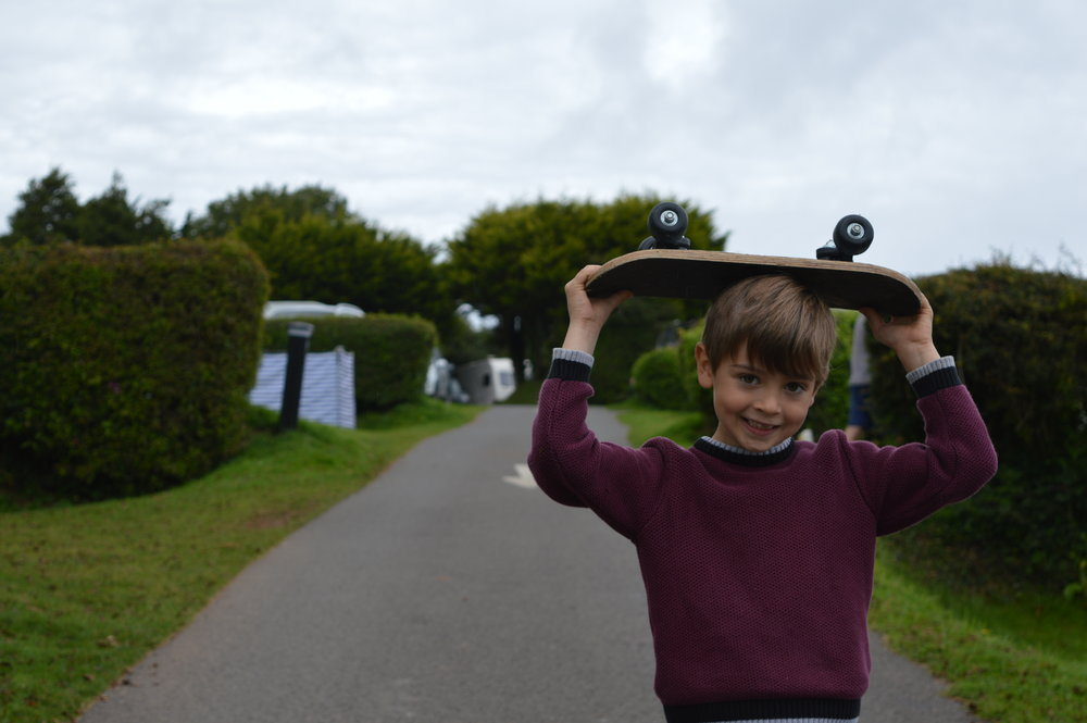 Apparently, this is the 'cool' way to carry your skateboard!