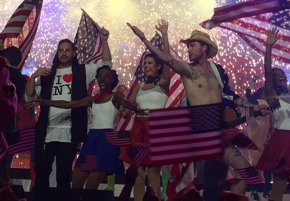 """Pastor Ben Houston on stage with fellow pastor and """"naked cowboy"""" Diego Simila"""