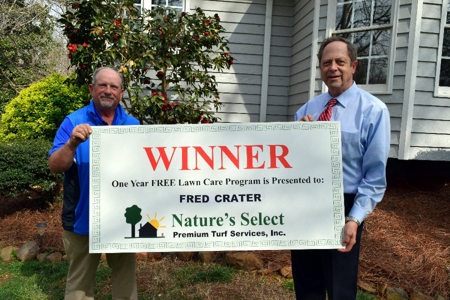 Left, Gene Queen, President of Nature's Select. Right, Fred Crater, the winner of one year of free lawn care from Nature's Select.