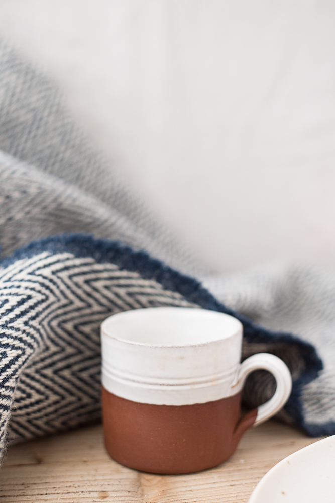 rough ceramic cup and blanket