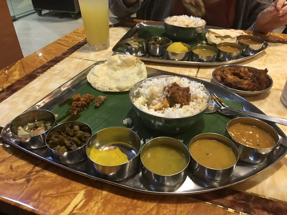 Indian banana leaf meal - lots of veggies in the small tins and some spicy chicken that we shared in the middle.
