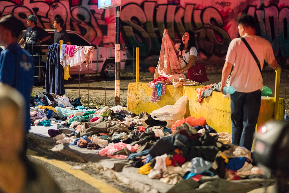 One of the businesses set on fire was a laundromat, and the family which owned it could be seen on the street with all of the clothes they managed to save, folding them and trying to figure what to do next.