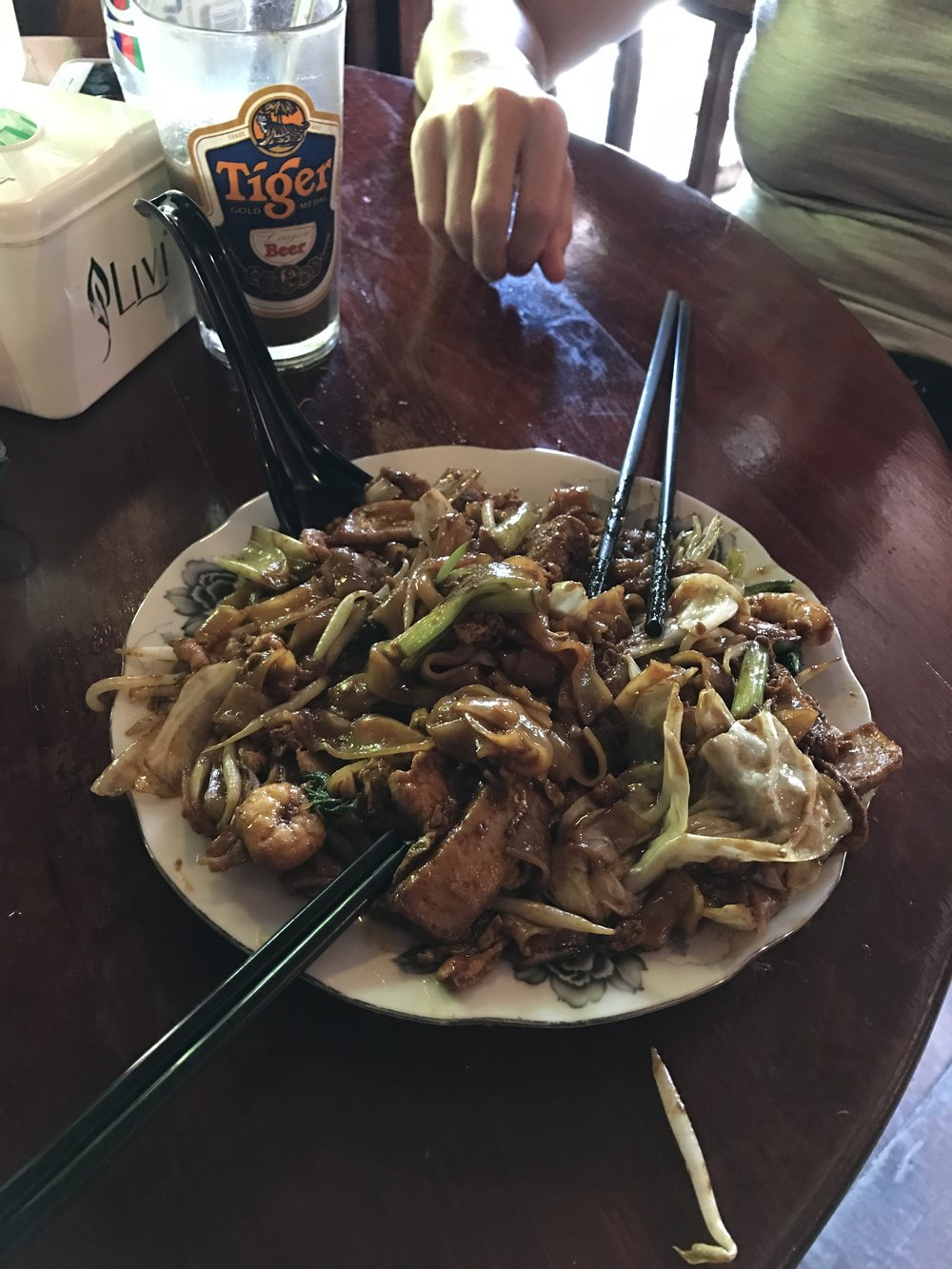 A giant plate of noodles, meat and veggies. It came with a raw egg on top to stir in. I wish I could remember what it was called.