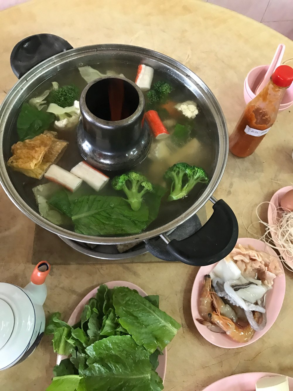 """Steamboat"" - fresh veggies, noodles, and meat (chicken, prawns, squid, etc) which you add to the boiling water in the middle to make a kind of soup. Delicious. The jellyfish was omitted."