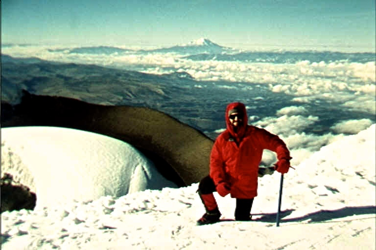The summit of Cotopaxi. On the horizon in the distance is Chimborazo.