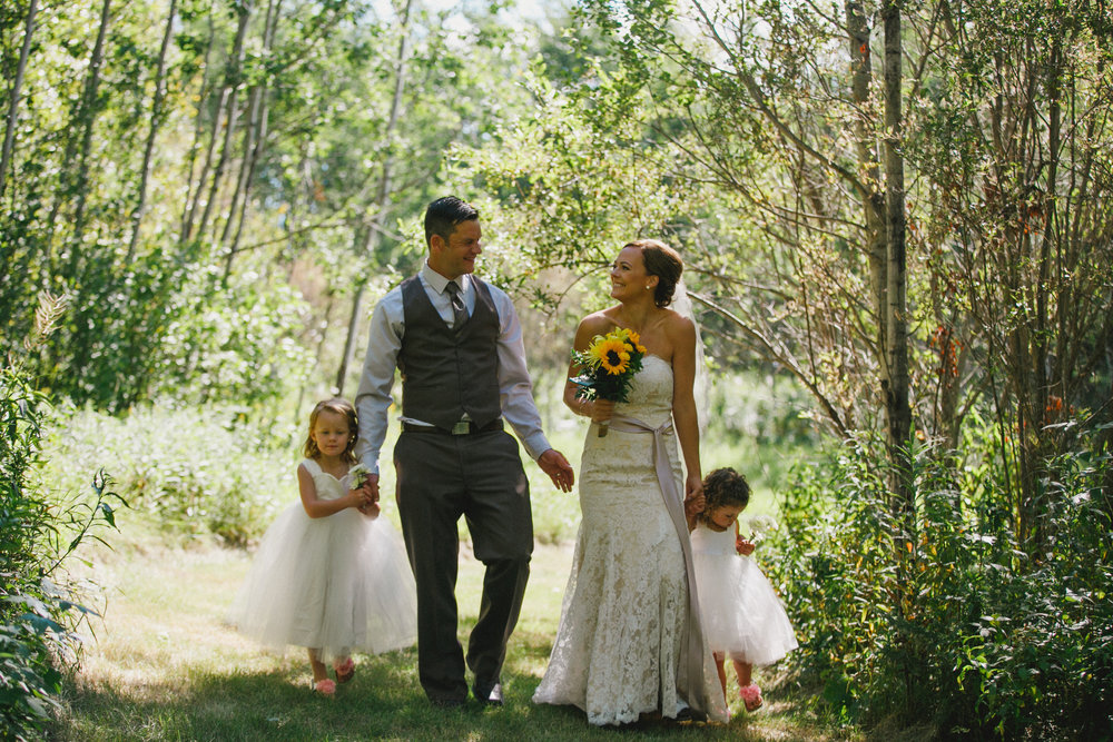 "moments after they said ""i do"" the sweet family walked into their yard to get the party started"