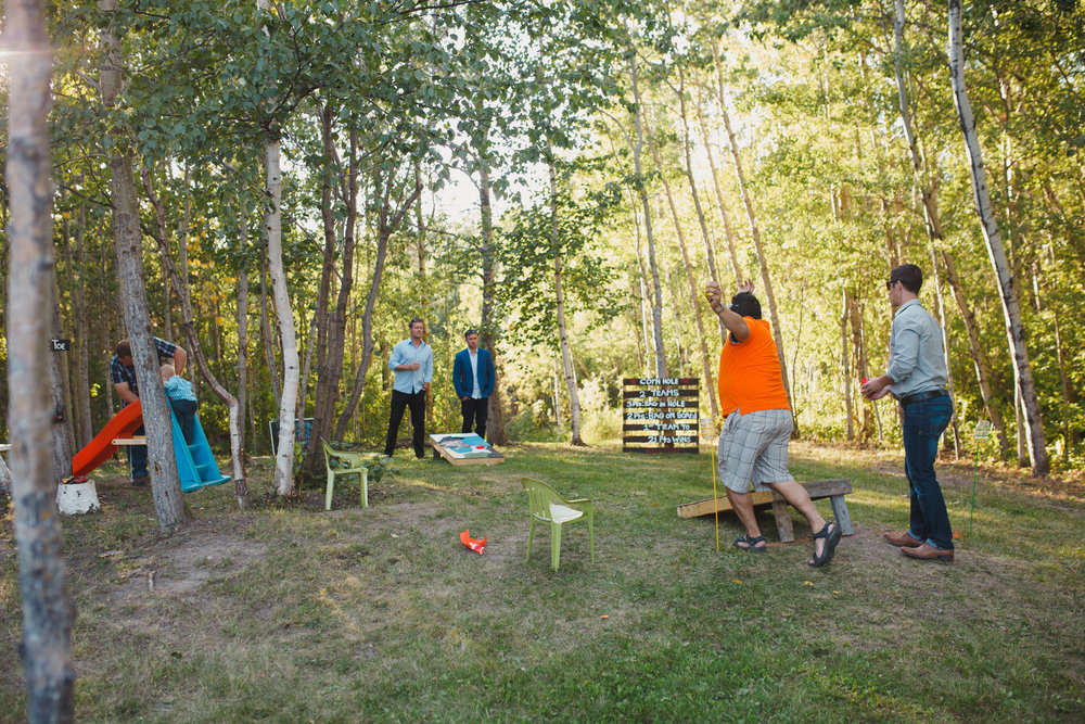 yard games were a hit for all ages at this family friendly backyard wedding near sherwood park