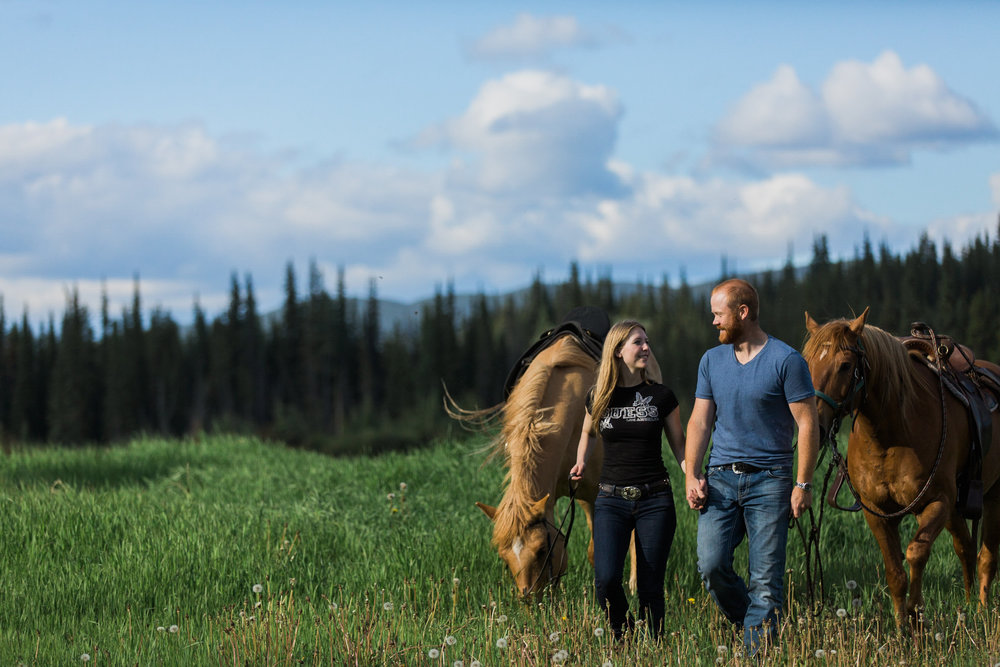 COURTNEY AND JOEL ENJOYING A HORSEBACK RIDE ON THEIR YUKON FARM