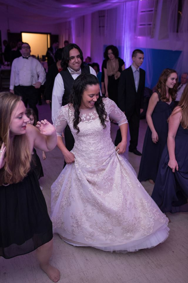 Bride dancing at reception in social hall.jpg