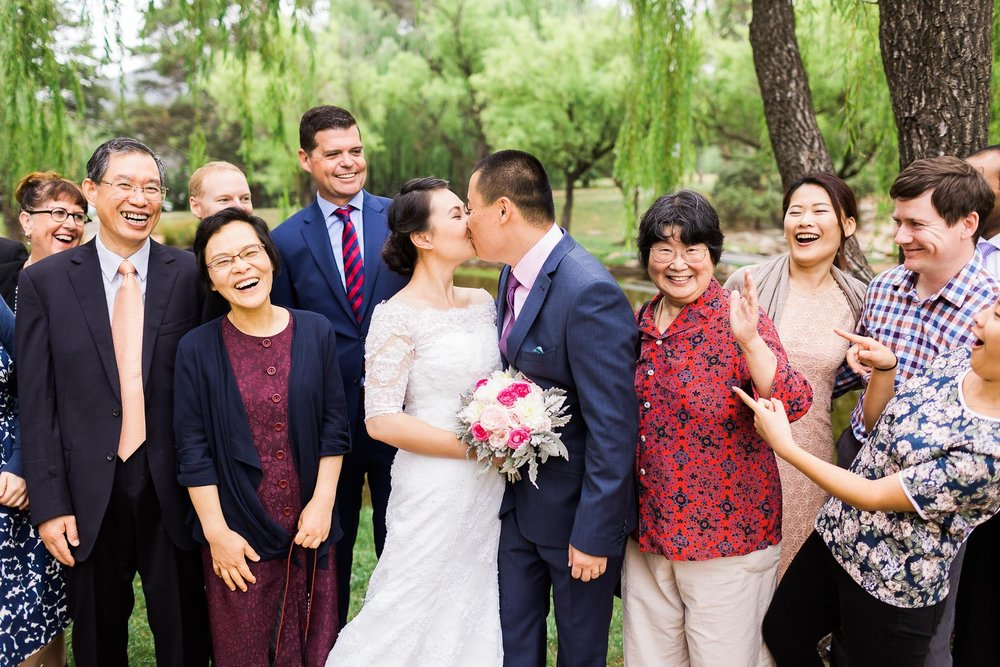 A fun kissing shot at a small wedding in Canberra