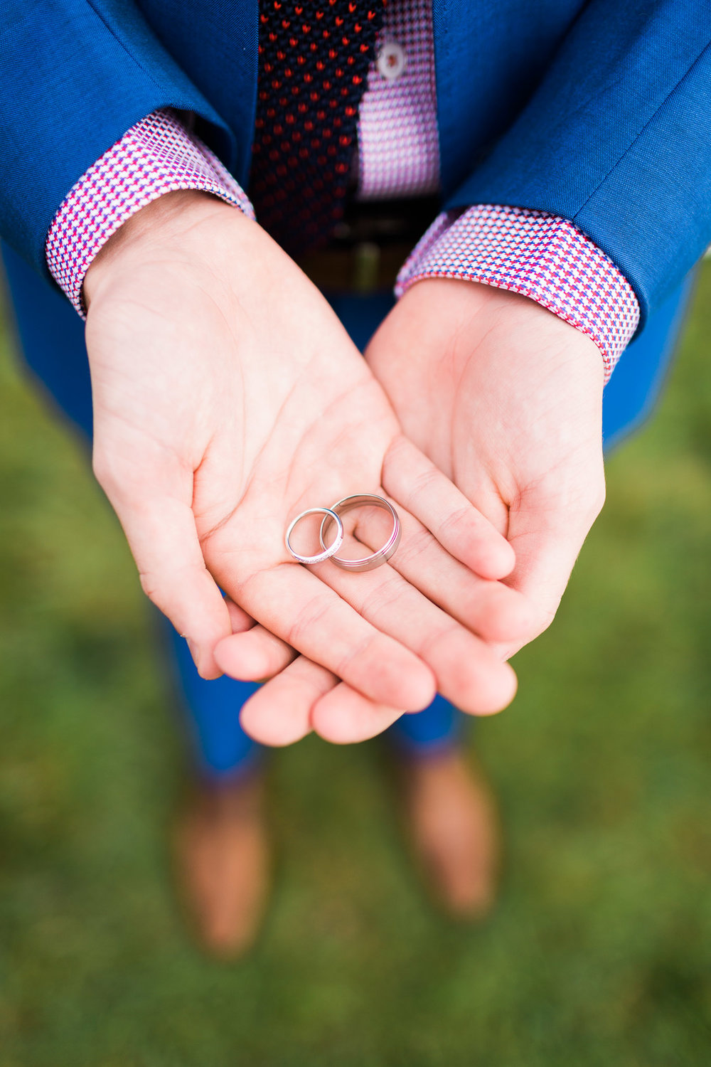 Groomsman holding rings at Pialligo Estate Small Wedding