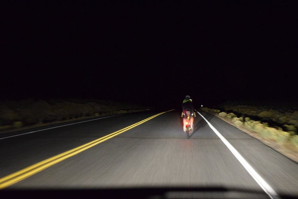 Riding up Austin Summit around 2:00 am. Photo by: Dave Machan.