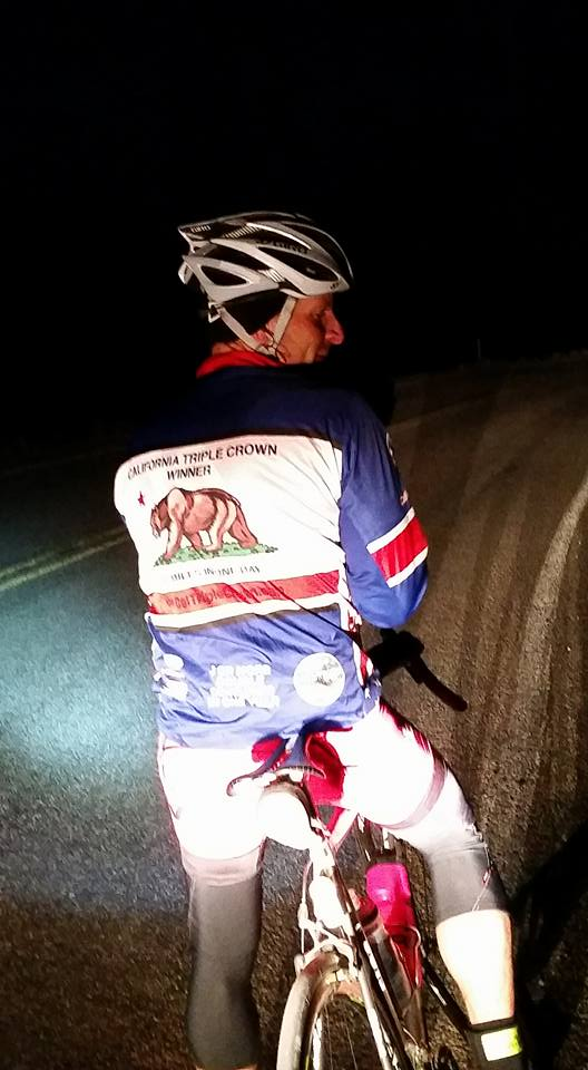 Brandon adjusts his gloves sometime around 4:00 am. It's brutally cold and dark, but he rides so fast. Photo by: Stacey Tinianov.