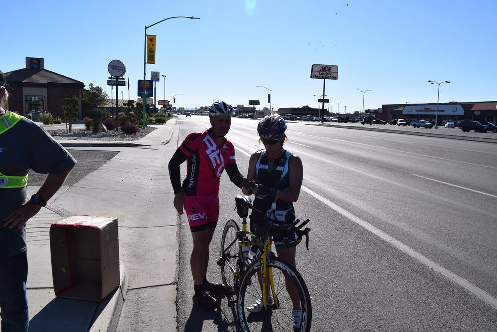 At a gas station on the West side of Fallon, Brandon hands me the GPS tracking device for my leg. Even though I know he needs to rest (after having ridden all night,) I plan on giving this last time trial leg all I've got. Photo by: Dave Machan
