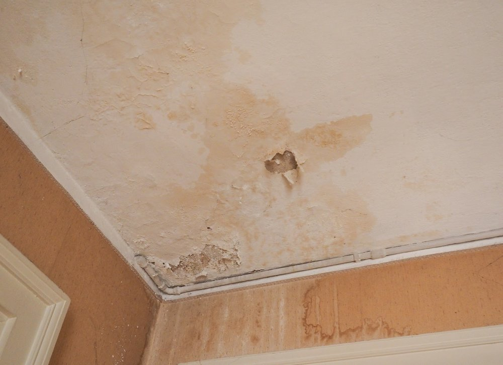 water pots on ceiling signs of roof damage.jpeg