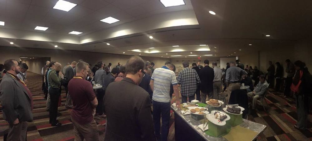 A time of prayer during the annual EPS reception. Though there are a lot of different views represented in the society, this is a great picture of what unites us. (Thanks to Mary Jo Sharp for the photo.)