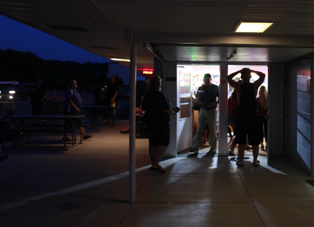 Visitors at the drive-in wait in line at the crowded concession shortly before the movie begins. Skyview's owners try to maintain reasonable snack prices for visitors of all economic standing so they can keep the tradition alive and accessible to everyone.