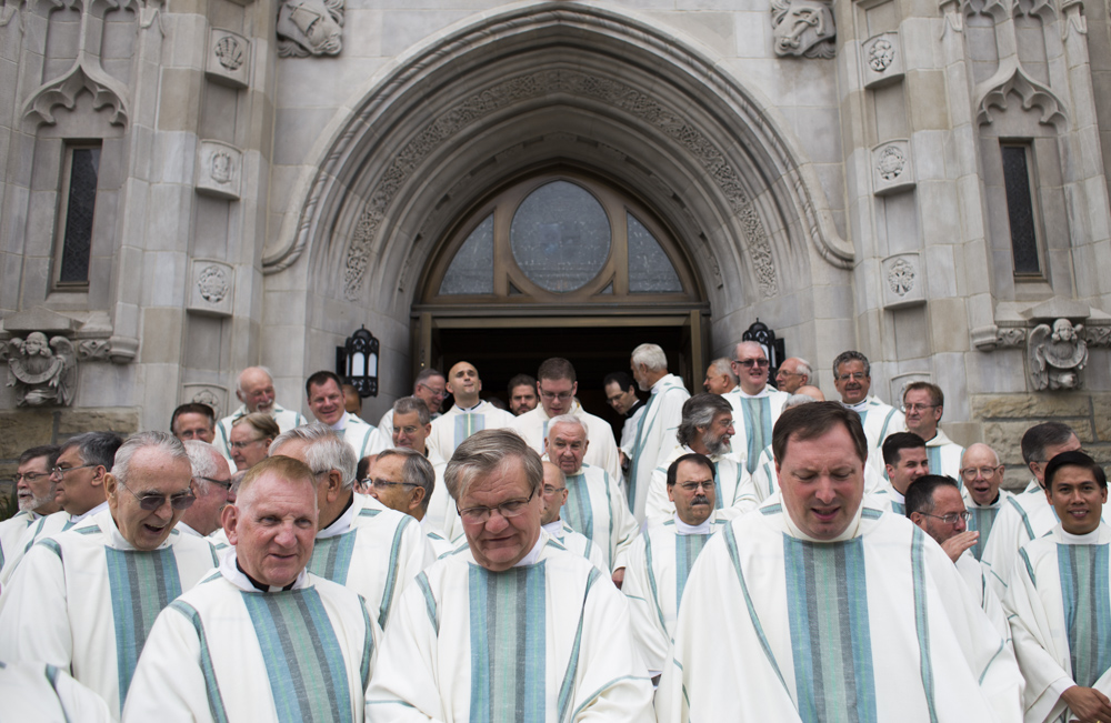 Priests exit the Blessed Sacrament Cathedral in Greensburg, Pa. after three deacons were ordained priests on Saturday, June 20, 2015.
