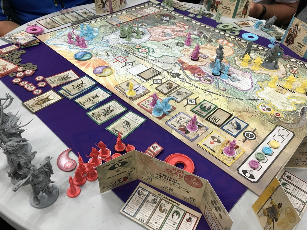 Rising Sun by Cmon looks great.  It reminds me of the old Milton Bradley game Shogun but with more Japanese fantasy twisted in.
