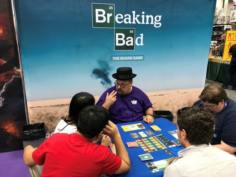 "I love the breaking bad tv show and i love board games, so how great to see them come together.  And the blue crystal bits used as ""Sky meth"" is clever.  I watched this handsome group play for a bit and I feel the game theme is too ""pasted on"" for what could have been a great in depth game."