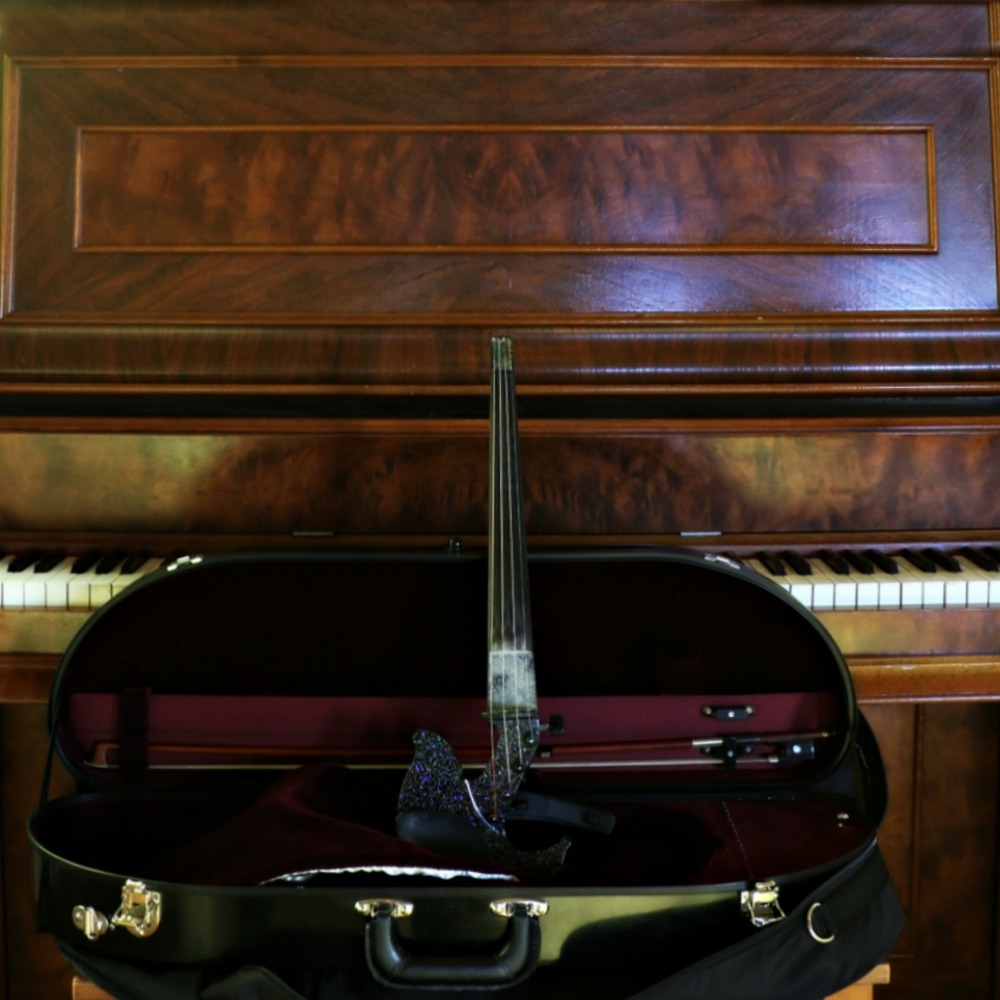 My electric violin on the Chapel's vintage piano