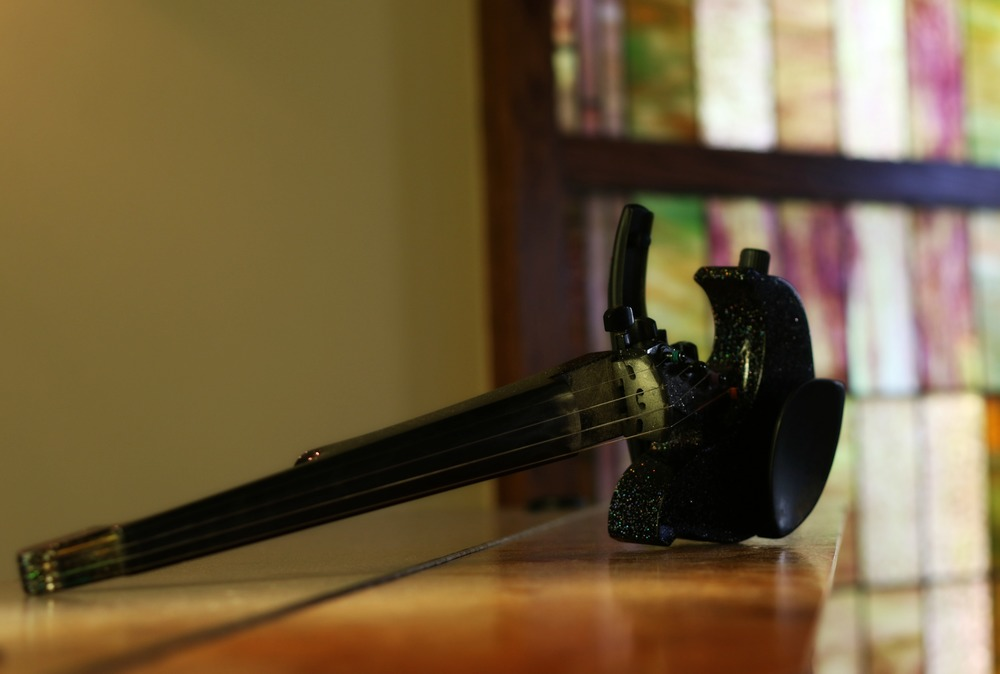 My electric violin in front of a stained glass window