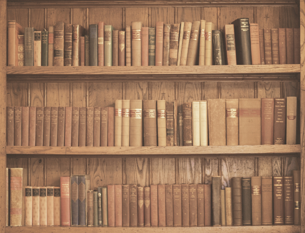 Antique books + bookcase photo taken at Historic Oak View County Park in Raleigh, North Carolina. | © Christy Hydeck