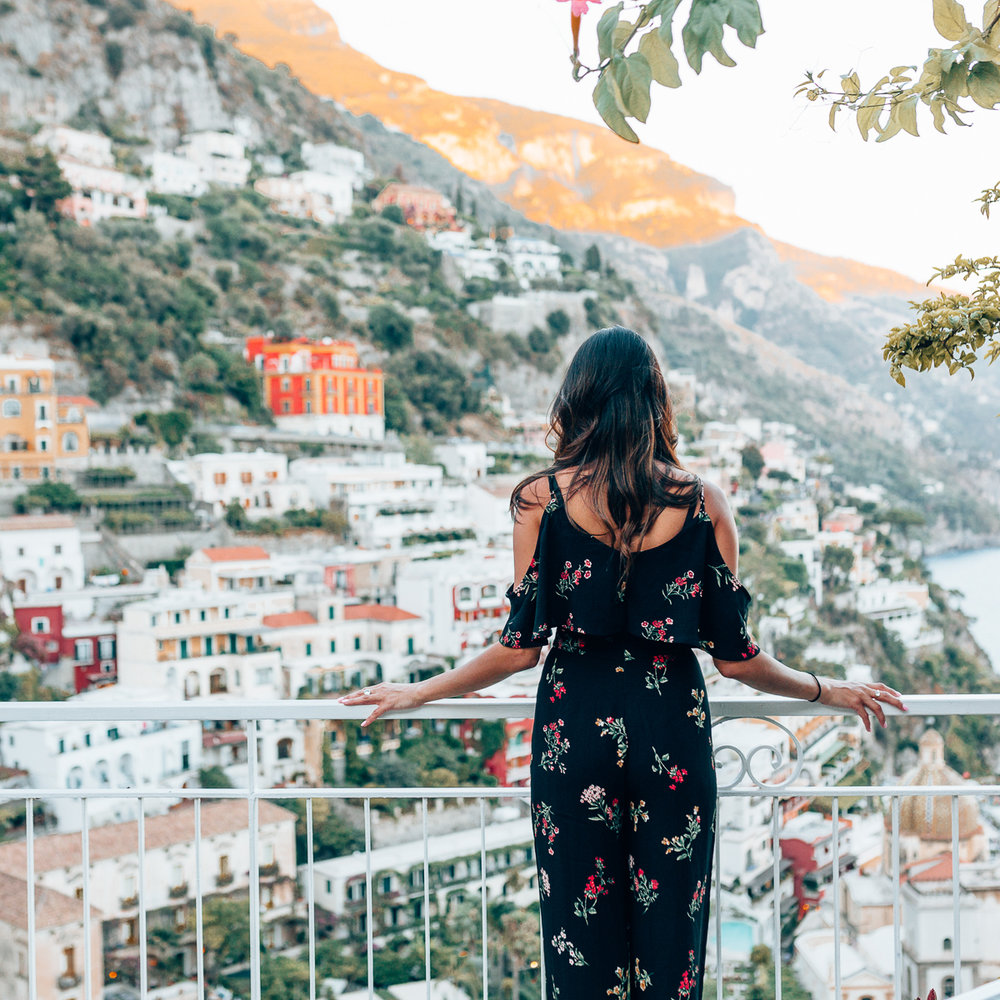 Italy outfit inspiration shot on our balcony in Positano, Italy. Check out my post to see pictures that will inspire you to add Positano to your Italy itinerary!