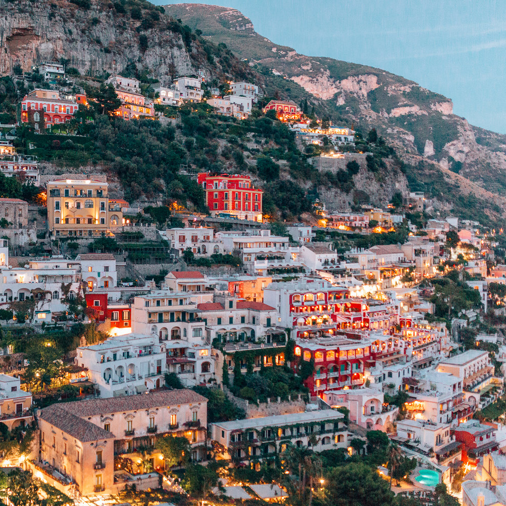 Positano in the Amalfi Coast at night. These pictures of the Italian coast will have you booking the next flight out to Italy ASAP.