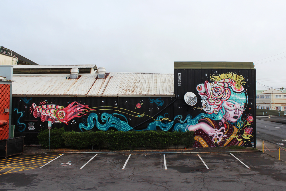 Completed mural by Lauren YS, located at 168 Keawe Street.