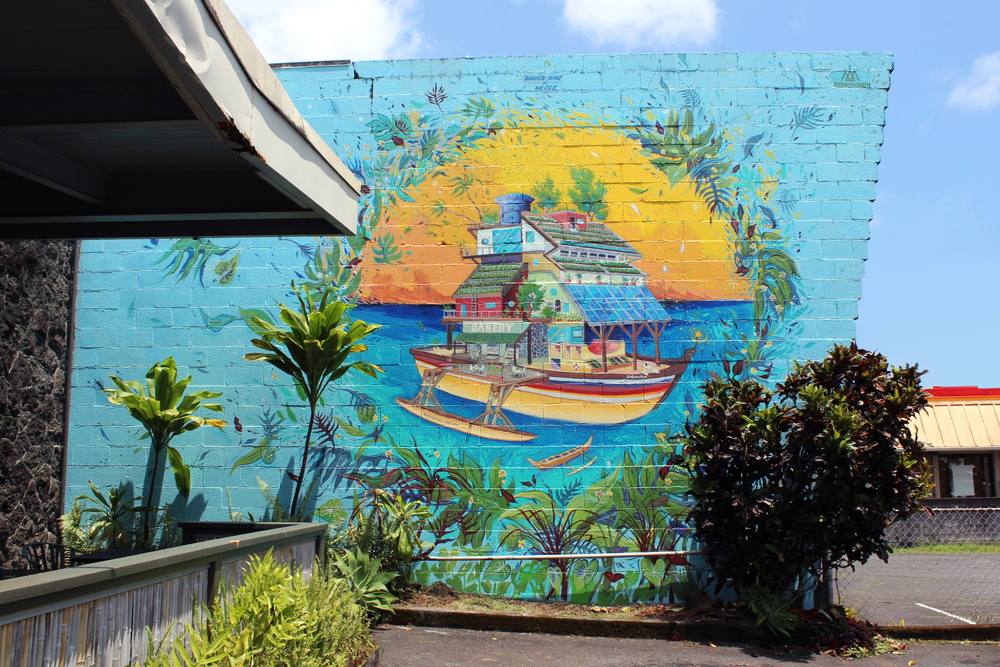 Completed mural by Wooden Wave and David 'MEGGS' Hooke, located at 374 Kinoole Street.