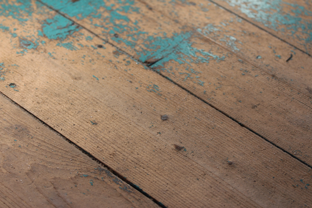 Significantly less turquoise paint on these wood floors, but just as much sand as I remember...