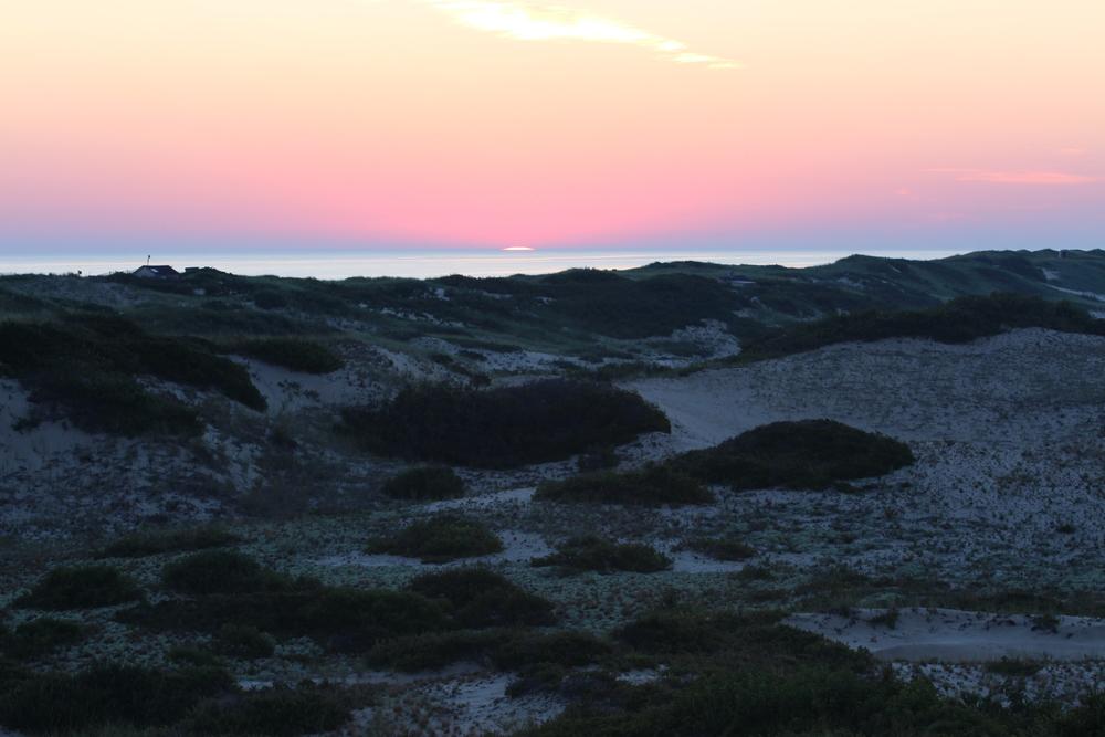 the dark dunes just before illumination
