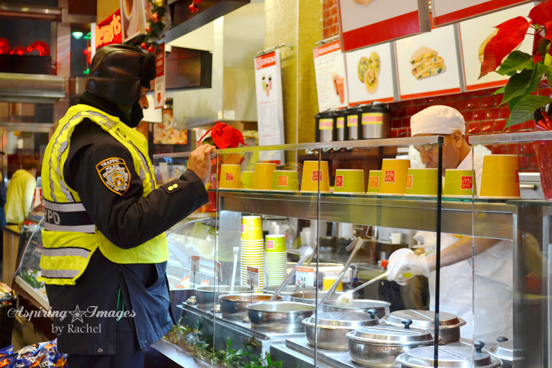 2010_Dec_NYC_Cop_Ordering_Food_small
