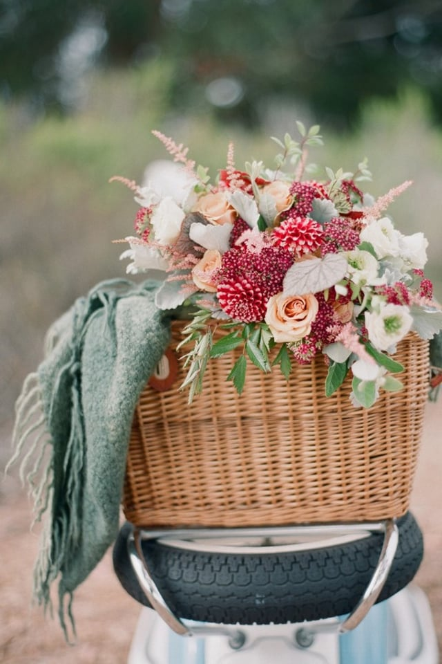 picnic and flowers on moped | Style Me Pretty