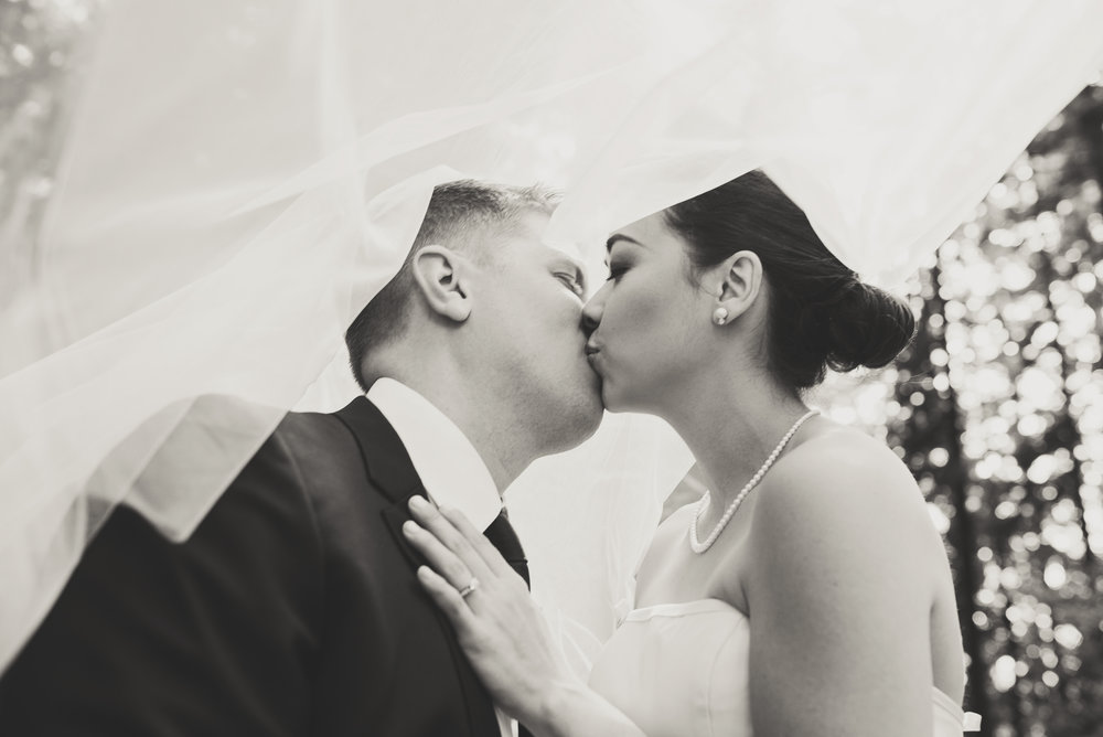 Edmunds Yacht Club Wedding_Montana Wedding Photographer_Missoula Wedding Photographer_Kelsey Lane Photography_bride and groom kissing under veil