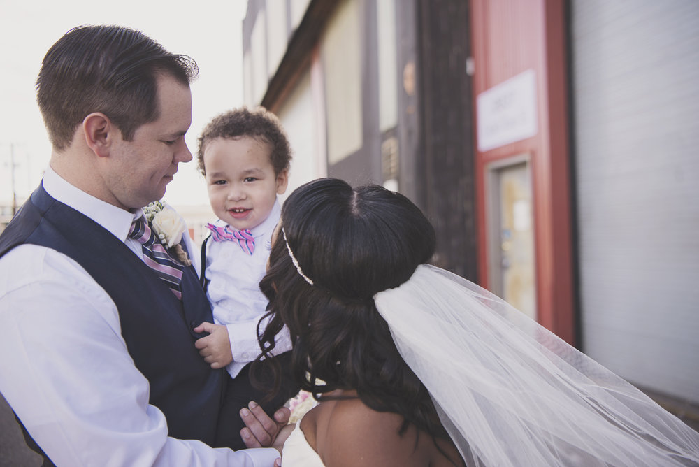 Gold Wedding_Montana Wedding Photographer_Within Sodo Wedding_Kelsey Lane Photography_bride and groom with kid