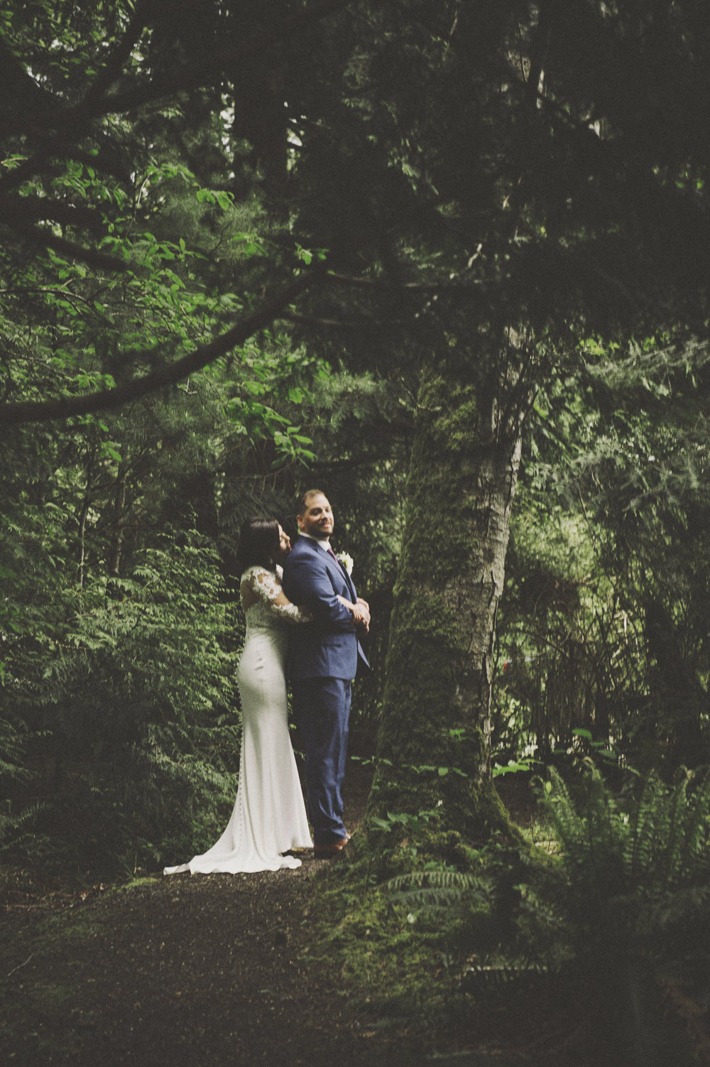 Woodsy Wedding_Kitsap Memorial State Park Wedding_Kelsey Lane Photography_bride and groom with ferns