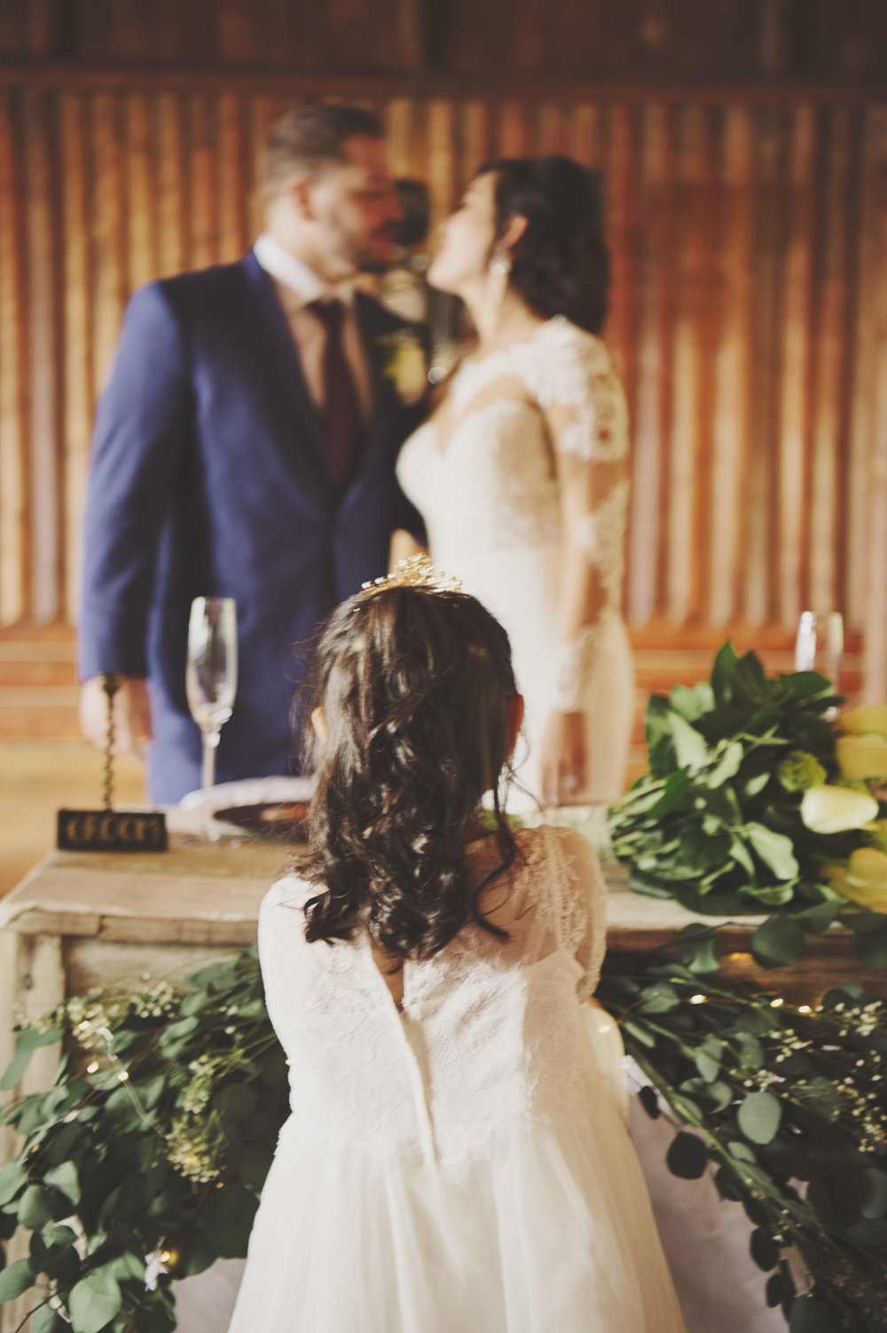 Woodsy Wedding_Kitsap Memorial State Park Wedding_Kelsey Lane Photography_kissing at reception