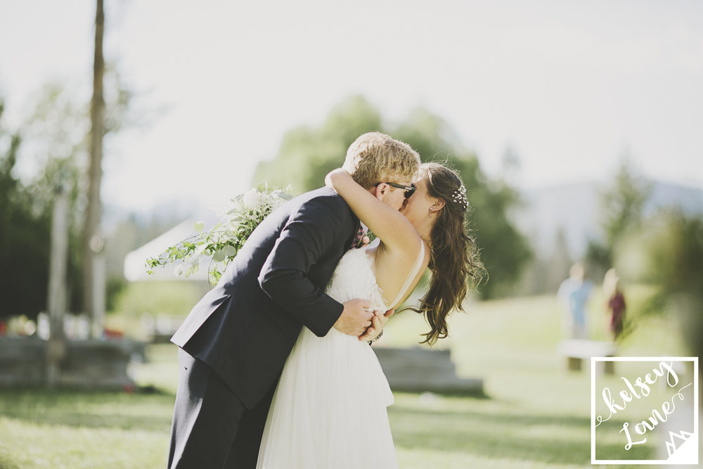 Rustic Montana Wedding_Soft Montana Wedding_Montana Wedding Photographer_Missoula Wedding Photographer_Grey Wolf Ranch_Kelsey Lane Photography_Bride and Groom Kiss