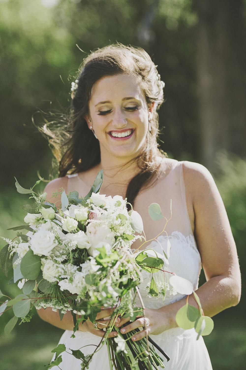 Montana Wedding Photographer_Seeley Lake Wedding_Blush Pink Montana Wedding_Kelsey Lane Photography_bride with flowers