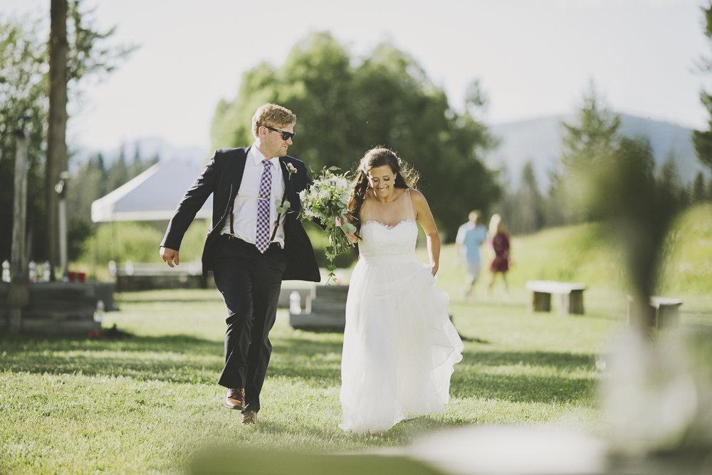 Montana Wedding Photographer_Seeley Lake Wedding_Blush Pink Montana Wedding_Kelsey Lane Photography_skipping bride and groom