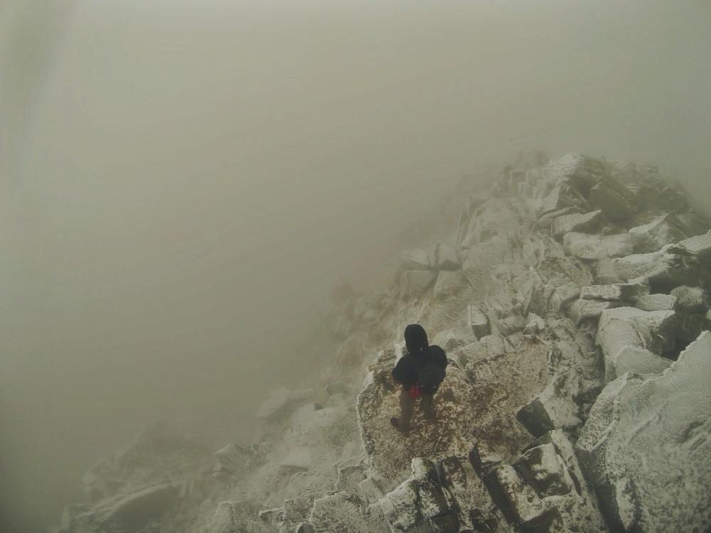 Teton observes the abyss below