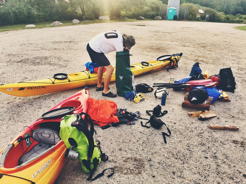 Corduroy and Teton get their gear ready before hitting the water on Cousins Island.
