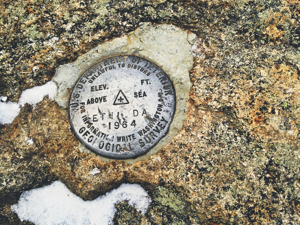 Summit marker for Mt. Bond (4,698 ft.)