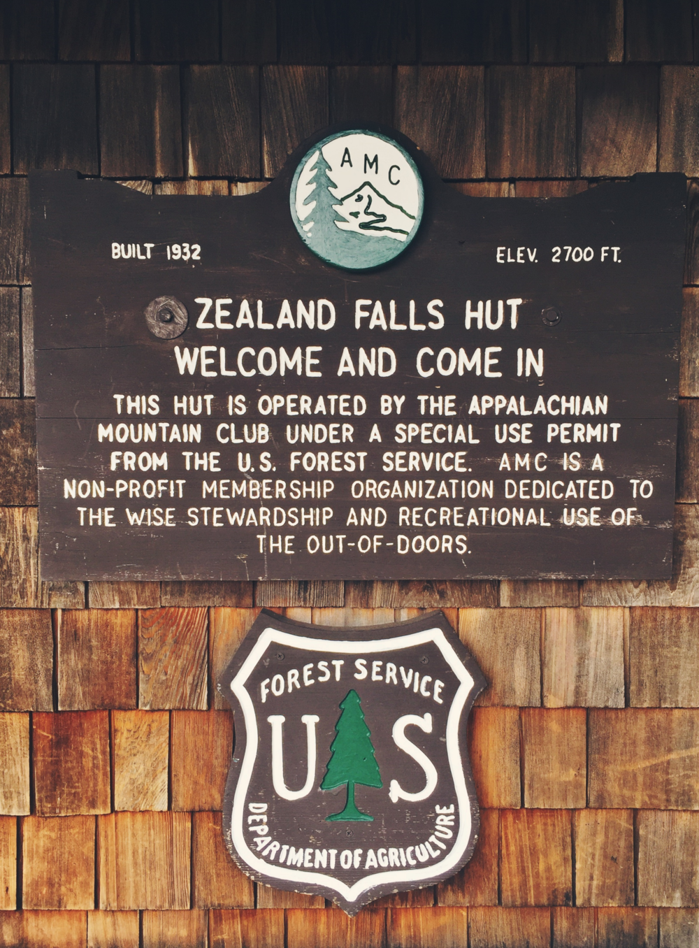 Zealand Falls Hut welcome sign.
