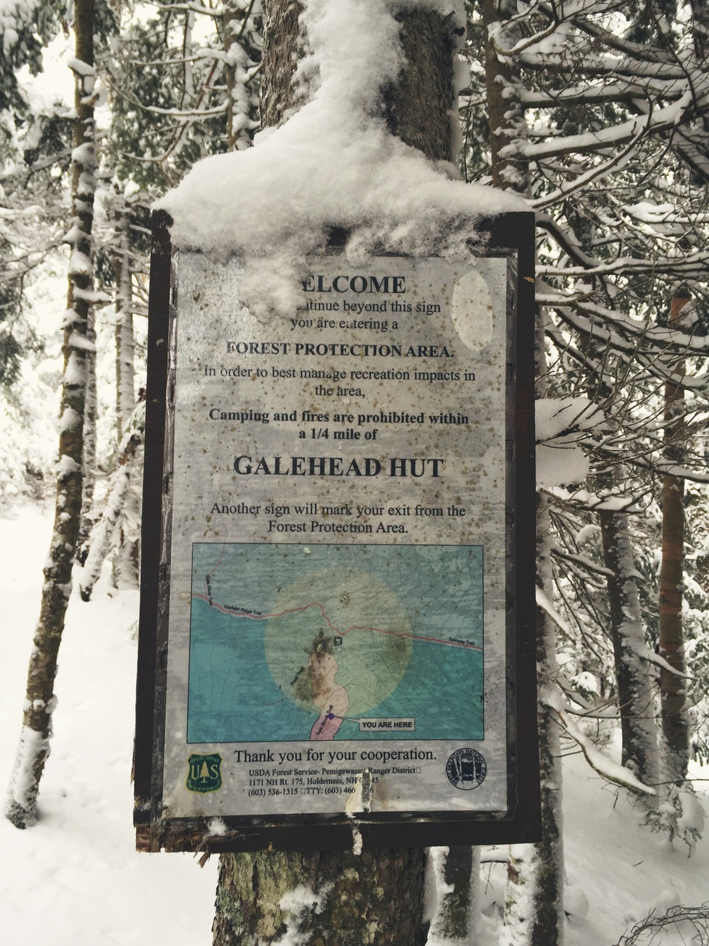 Our first sign after 2.7 miles of blindly hiking through the snow